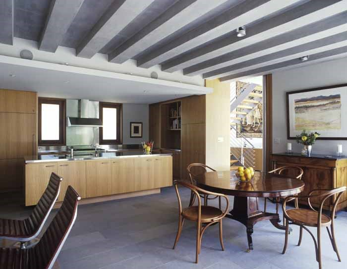 Concrete beams, limestone floors, timber finishes throughout the interiors